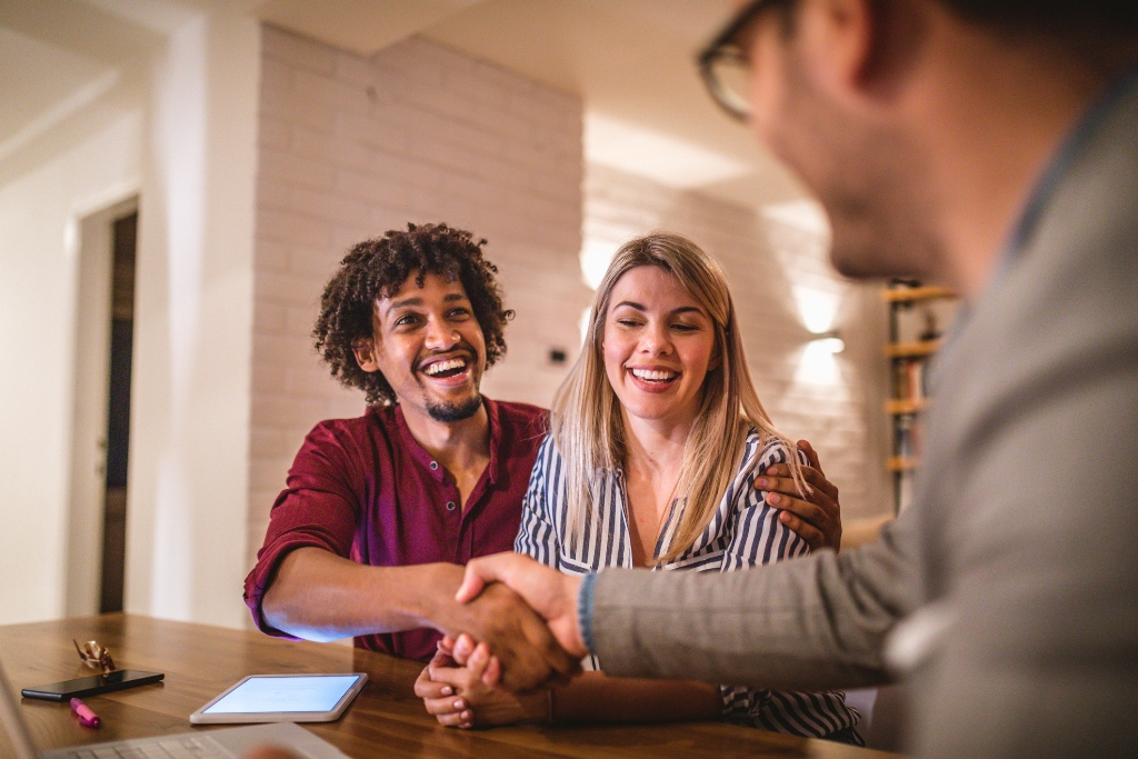 couple negotiating to their real estate agents in california