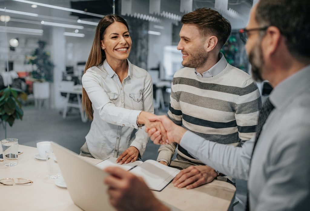 Handshaking while settling a deal with real estate agents
