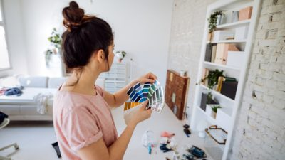 A woman choosing a color for her wall.